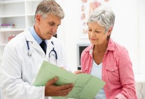 Doctor showing the benefits of Medicare Part C